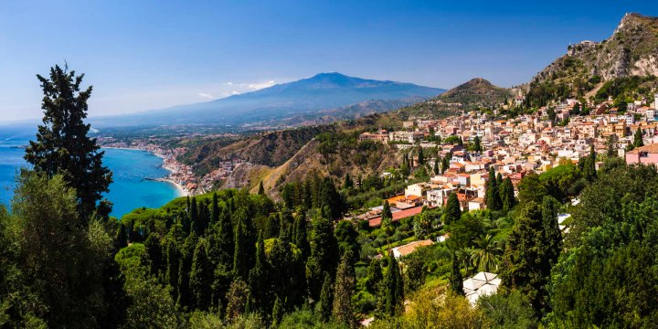 Taormina, Sicily, Italy. Mount Etna Volcano and Taormina seen from Teatro Greco aka Greek Theatre or Amphitheatre, Sicily, Italy, by freelance travel and destination photographer Matthew Williams-Ellis