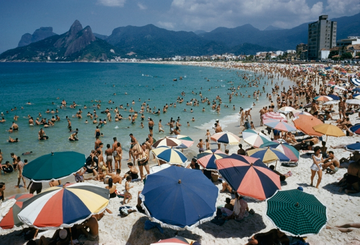 Umbrellas and swimmers dot Arpoador Beach in Rio de Janiero, Brazil, March 1955. Photo by CharlesAllmon